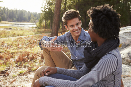happy mixed race couple talking in
