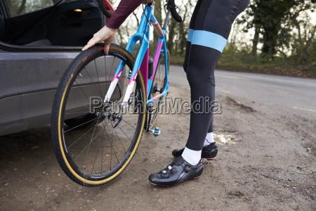 cyclist preparing his bike for a