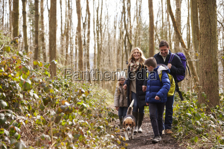family with pet dog walk through