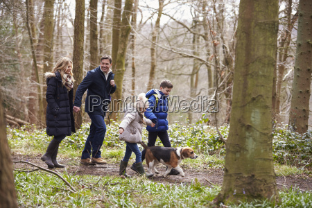 side view of family walking pet