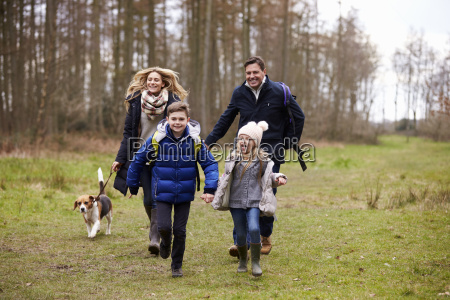 family walking dog together in the