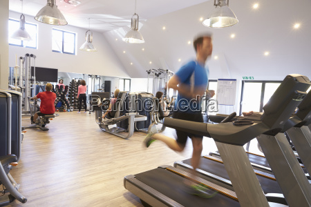 people exercising in a gym blurred