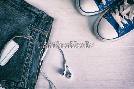 blue faded jeans and blue sneakers