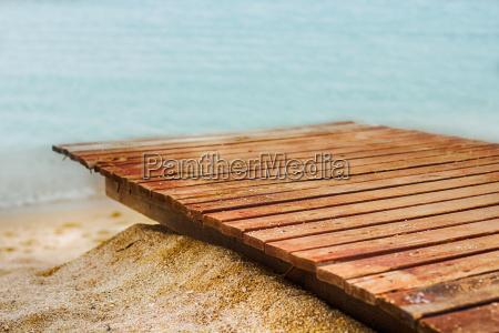 wooden path on sand beach sea