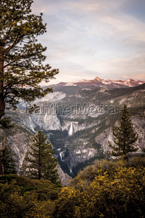 a view of mountains and waterfalls