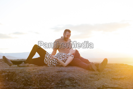 lifestyle portrait of an engaged couple