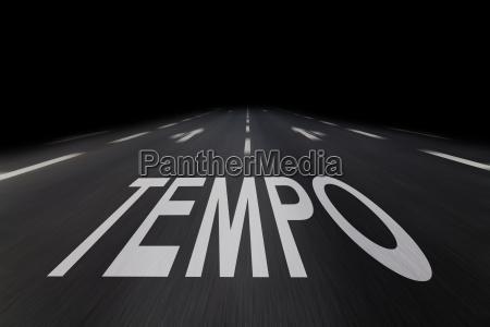tempo written on asphalt