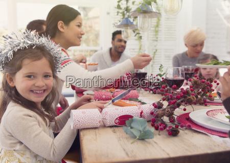 portrait smiling girl enjoying christmas dinner