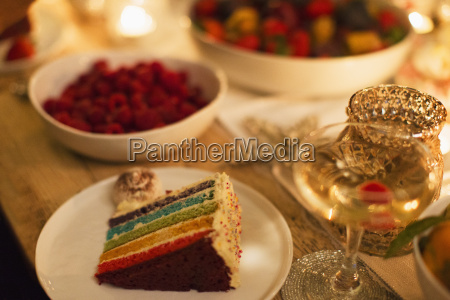 layer cake and champagne on table