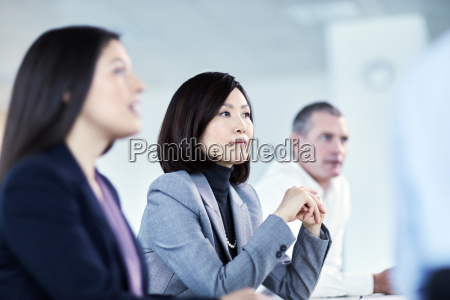 attentive serious businesswoman listening in meeting