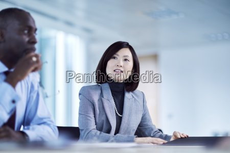 serious businesswoman listening in meeting