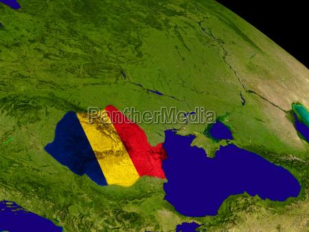 romania with flag on earth