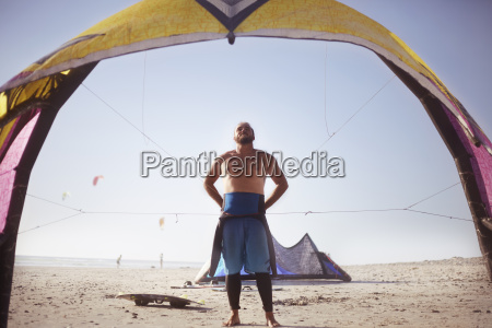 man preparing to kiteboard on sunny