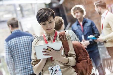young woman using digital tablet at