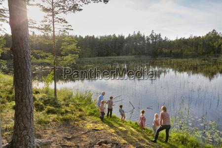grandparents and grandchildren fishing at sunny