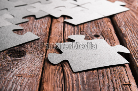 incomplete puzzles lying on wooden rustic