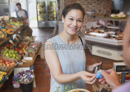 woman paying with credit card at