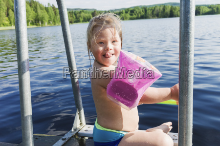 girl with down syndrome wearing water