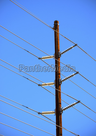 hydro wires against blue sky canada