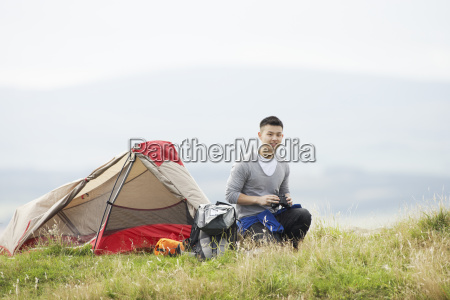 young man on camping trip in