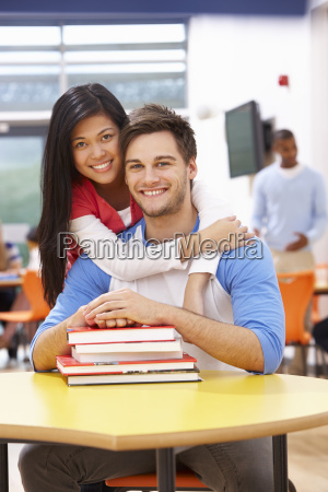 male and female students studying in