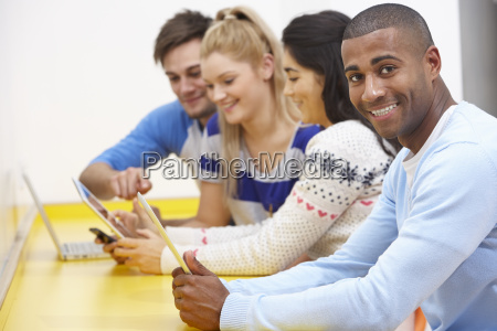 group of college students using digital