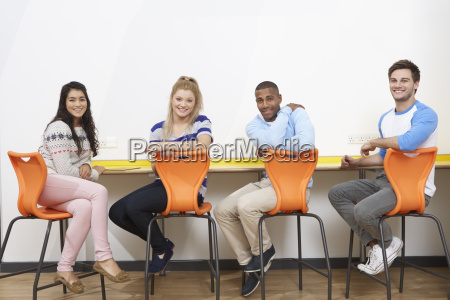 group of college students working at