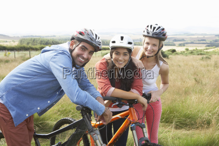 group, of, young, people, cycling, in - 19407538