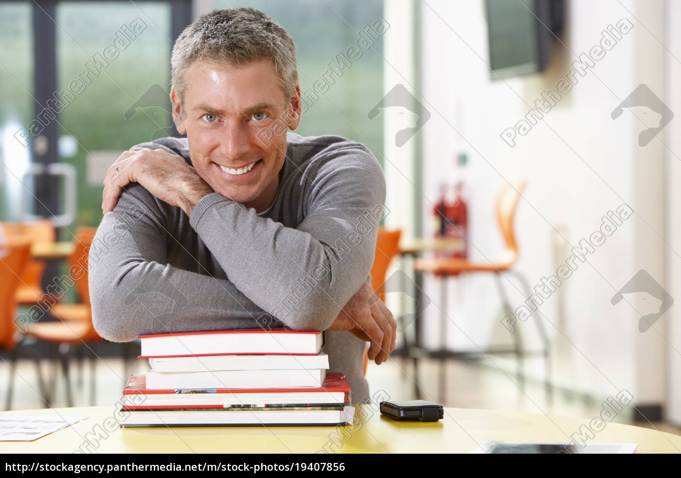 male, mature, student, studying, in, classroom - 19407856