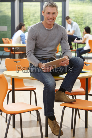 male, tutor, sitting, in, classroom, with - 19407696
