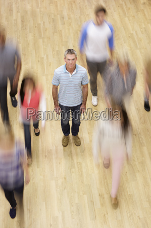 overhead, view, of, man, surrounded, by - 19407988
