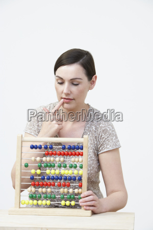 puzzled, woman, using, abacus - 19407418