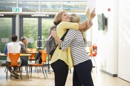 teacher, congratulating, pupil, on, successful, exam - 19407794