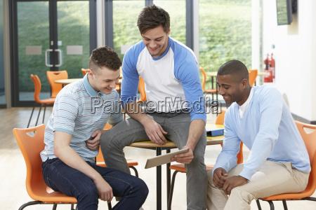 three, male, students, looking, at, digital - 19407664