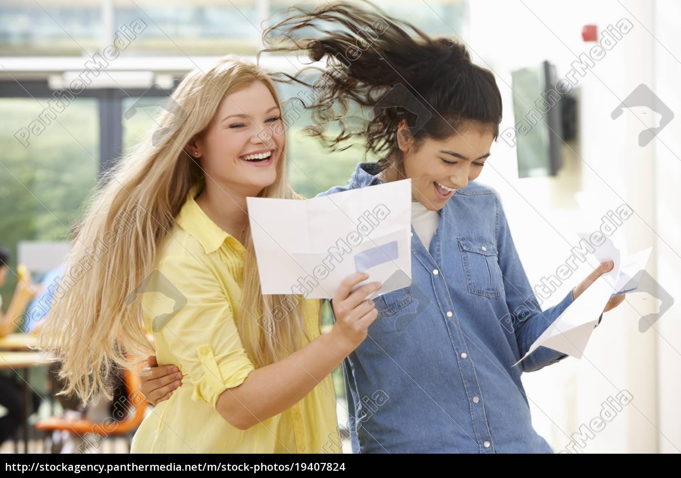 two, teenage, pupils, celebrating, successful, exam - 19407824
