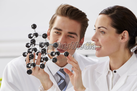 two technicians looking at molecular model