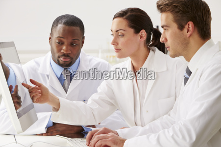 group of scientists checking laboratory results