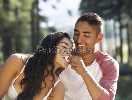 young couple enjoying picnic in countryside