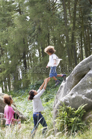 father helping son to jump off