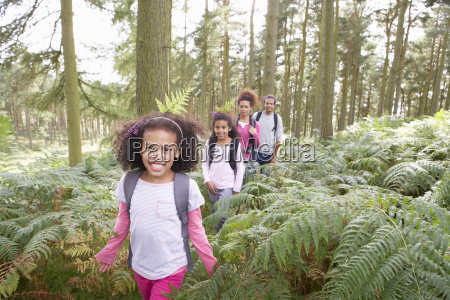 family group hiking in woods together