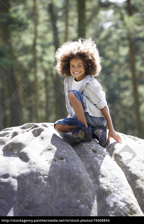 boy, climbing, on, rock, in, countryside - 19408894
