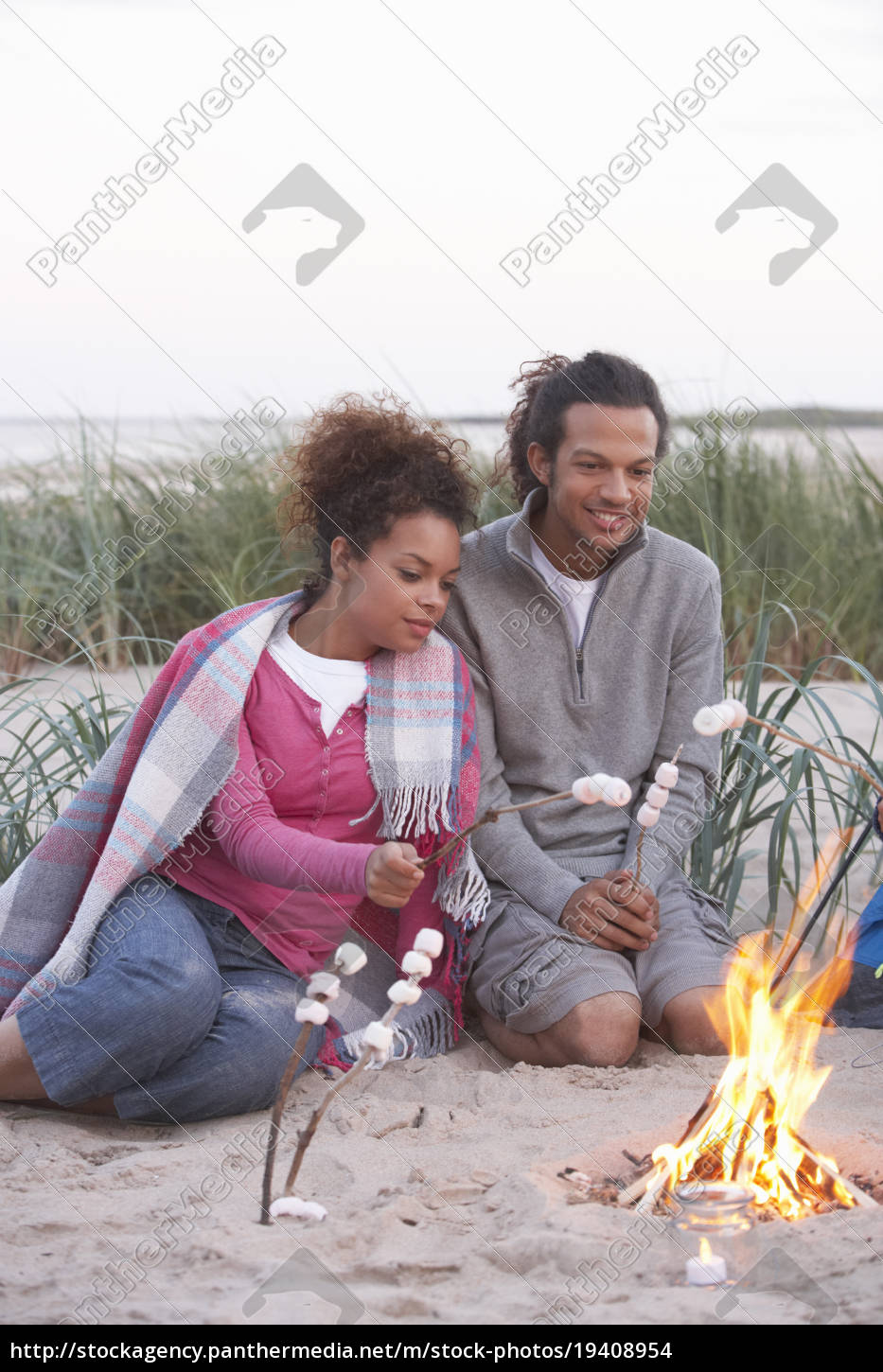 couple, camping, on, beach, and, toasting - 19408954
