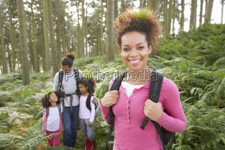 family, group, hiking, in, woods, together - 19408980