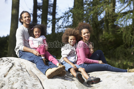 family, group, sitting, on, rock, together - 19408908