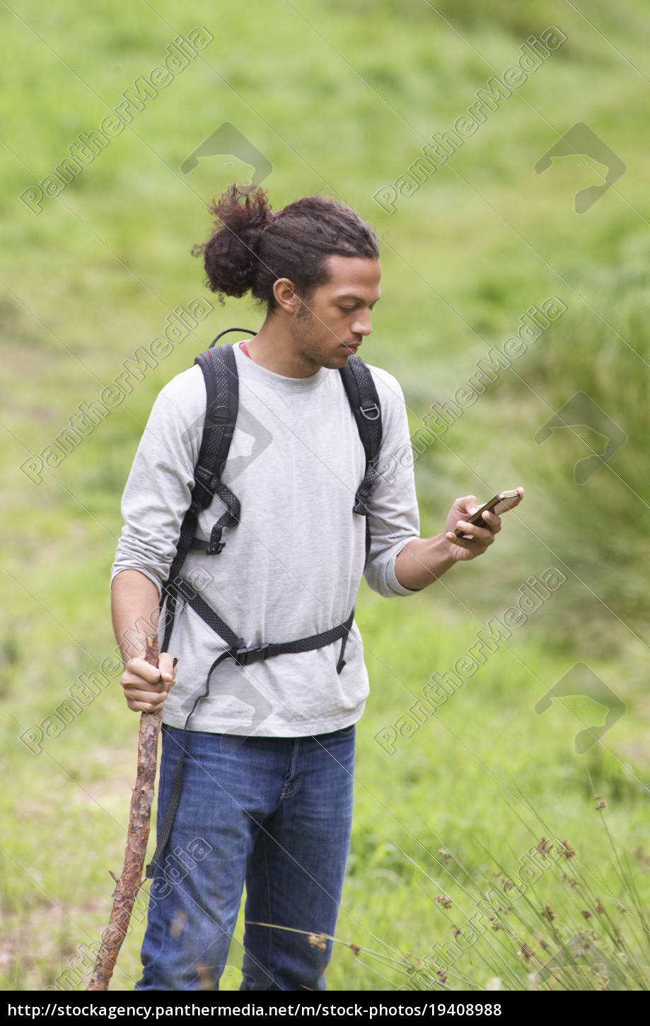 man, using, mobile, phone, whilst, hiking - 19408988