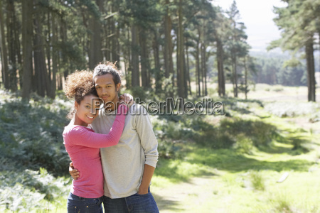 romantic, young, couple, walking, in, countryside - 19408852