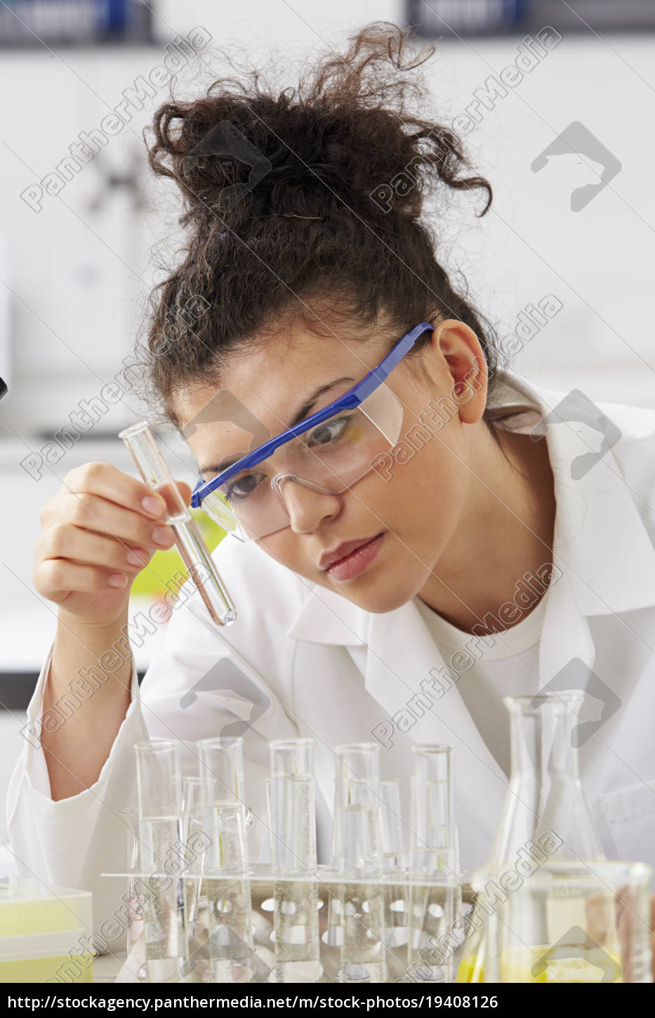 scientist, studying, test, tubes, in, rack - 19408126