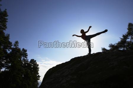 silhouette, of, teenage, girl, balancing, on - 19408696