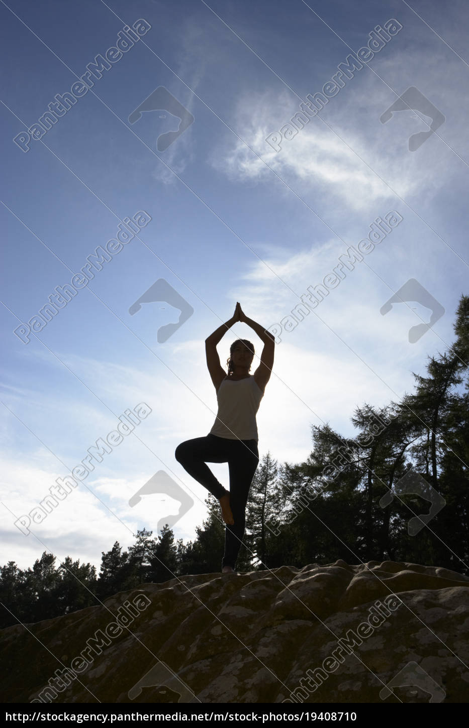 silhouette, of, teenage, girl, meditating, outdoors - 19408710