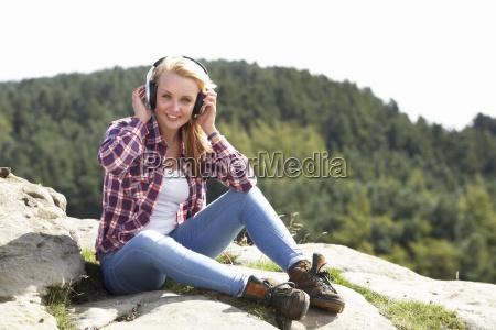 teenage, girl, listening, to, music, in - 19408598